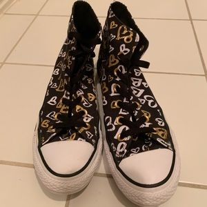 Girls black, white, and gold converse